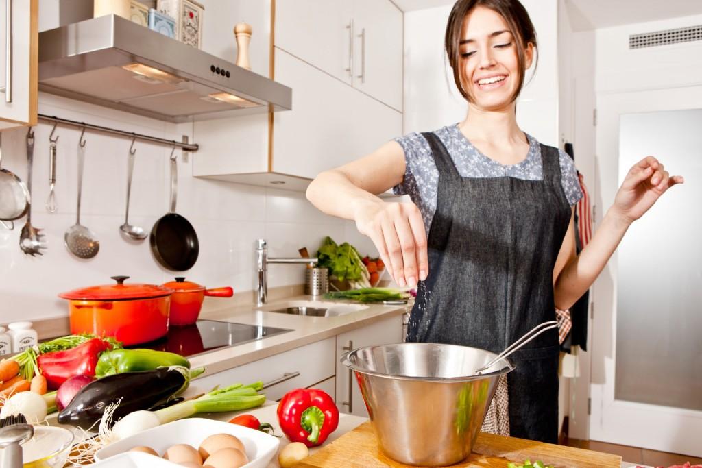 Woman seasoning food